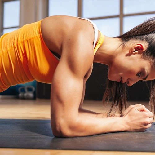 Hardcore classes with a woman flexing and strengthening her core